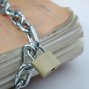 Photo of book with chain and padlock