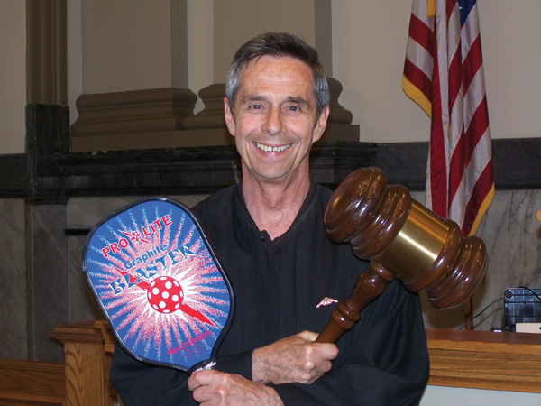 Judge Adler with Pickleball racquet and Gavel