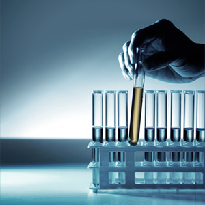 Photo of a hand pulling a test tube from a rack