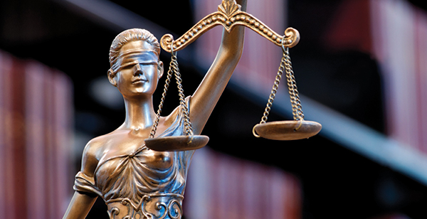 Image of lady justice holding scales