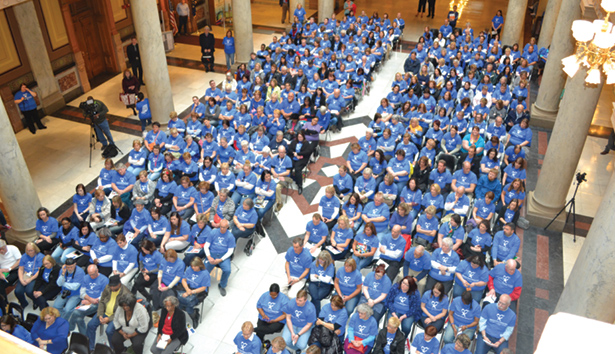 Hundreds of CASA volunteers fill the North Atrium of the State House