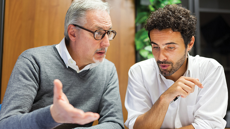 A discussion between and older and younger employee