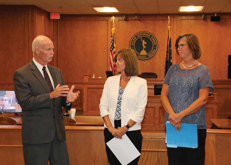 Allen County Commissioners Nelson Peters and Therese Brown, present the Commissioners' Civil Service Award to Trish Gratz, Court Reporter to Judge Craig Bobay.