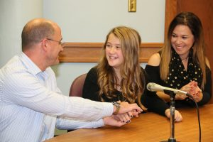 A family enjoys a special moment during adoption proceedings in Allen County.