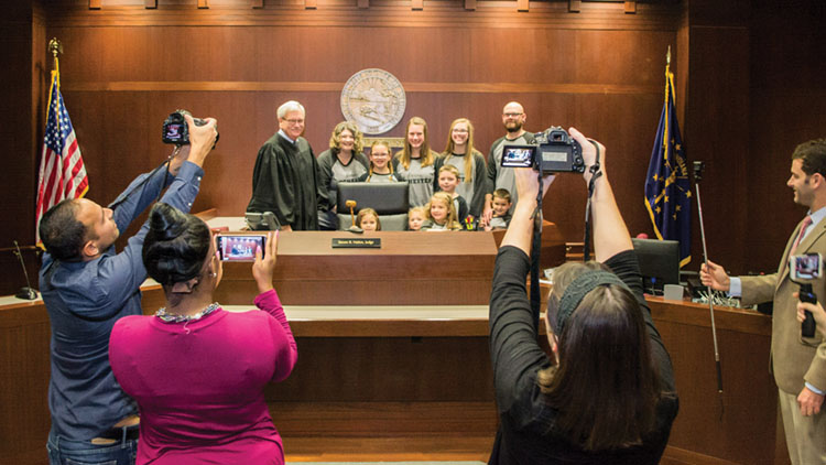 Judge Steven Nation (Hamilton) and a family after adoption proceeding.