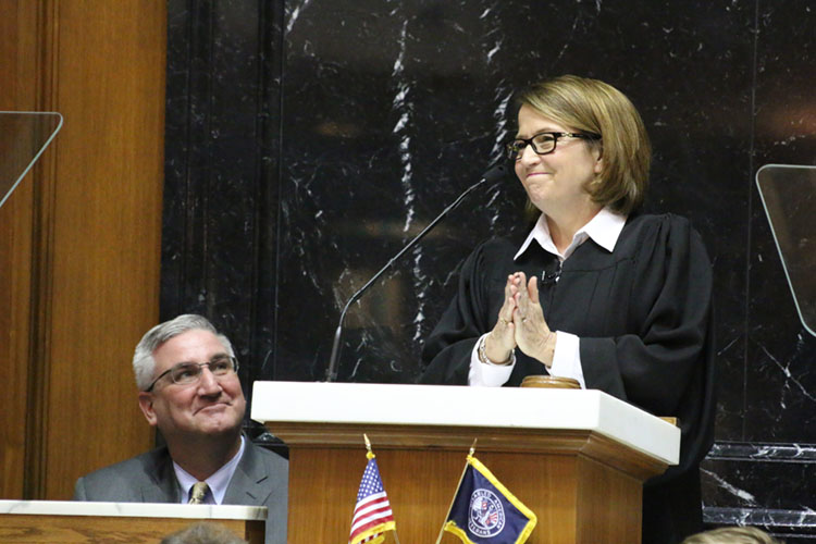Chief Justice Loretta Rush and Governor Eric Holcomb