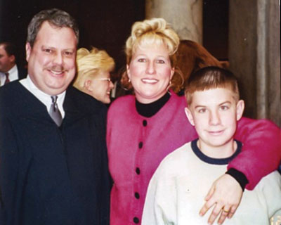 Judge Bill Nelson with his wife, Kristina, and stepson, Bryan.