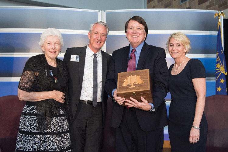 Former Chief Justice Randall T. Shepard with others after receiving the Heritage Keeper Award from the Indiana State Museum.