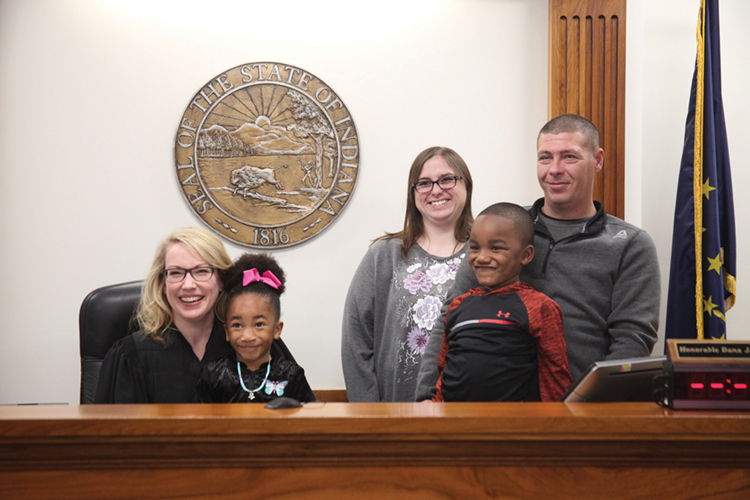 Judge Dana Kenworthy with a family during an adoption proceeding in Grant County