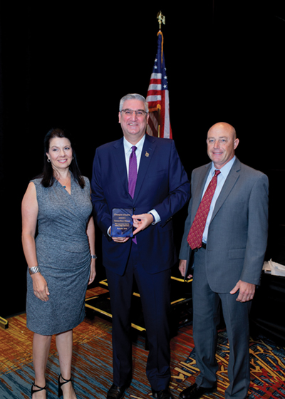 Governor Eric Holcomb, his wife, and IJA President Robert Freese