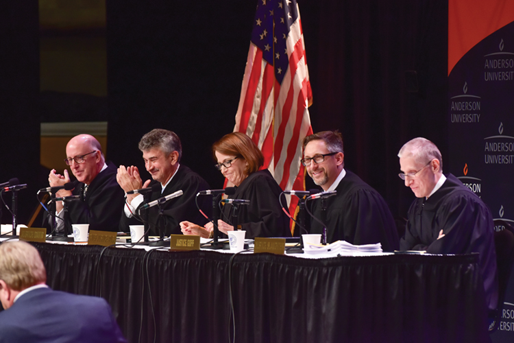 Members of the Indiana Supreme Court smile during oral arguments at Anderson University in Madison County.