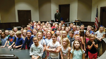 Judge Foley with a group of third-grade students.