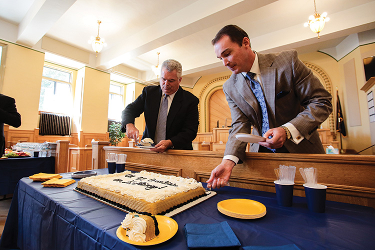 Sullivan County judges cut a cake in the courtroom