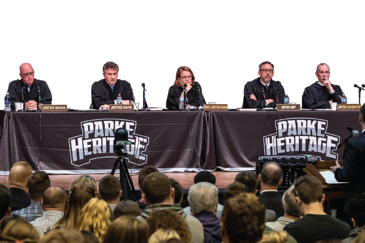From left, Justice Mark Massa, Justice Steven David, Chief Justice Loretta Rush, Justice Christopher Goff, and Justice Geoffrey Slaughter sit on the bench at Parke Heritage High School. Photo by Chris Bucher