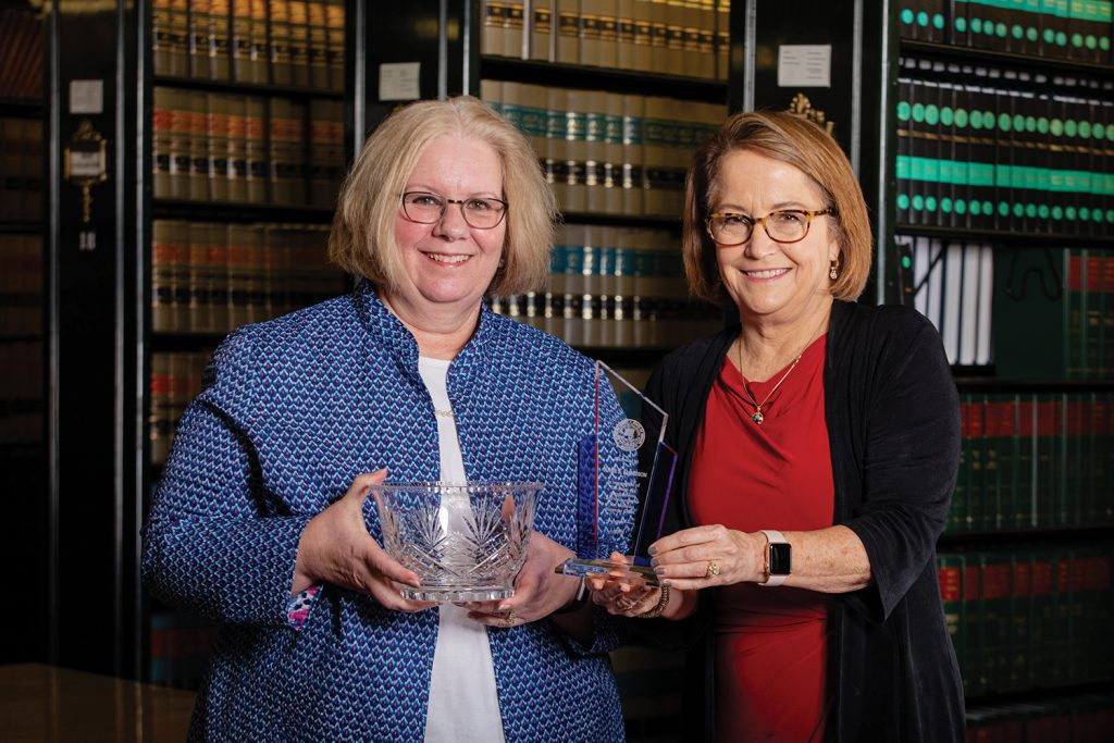 Anne Davidson poses for a photo with Chief Justice Rush.