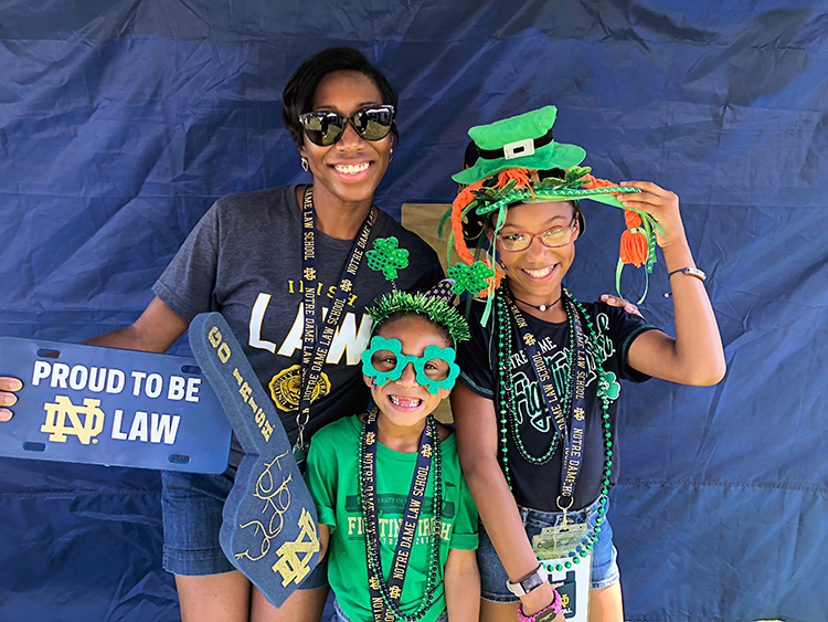 Magistrate Cristal Brisco and her two daughters Alexa and Brianna dress up in Notre Dame attire.