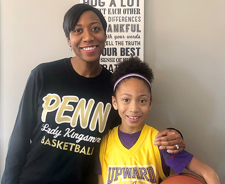 Magistrate Brisco and her daughter Alexa, who wears a yellow jersey while holding a basketball.
