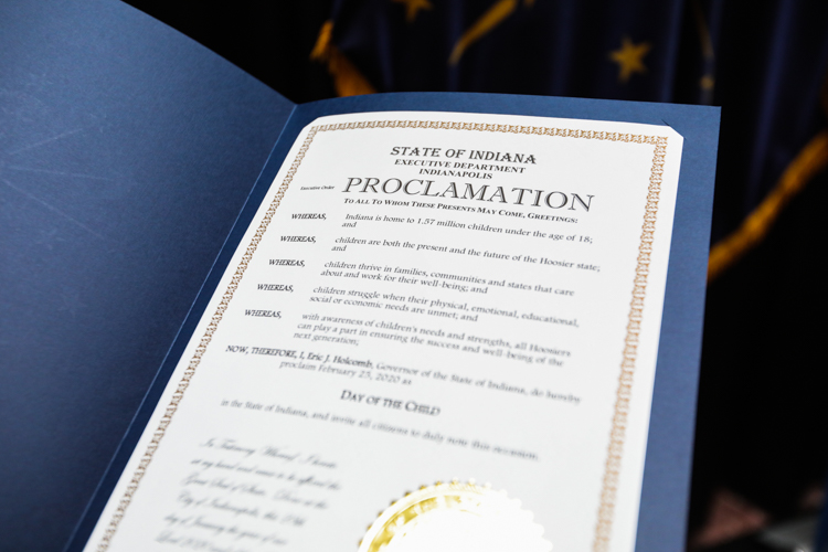 Signed proclamation in a blue folder.