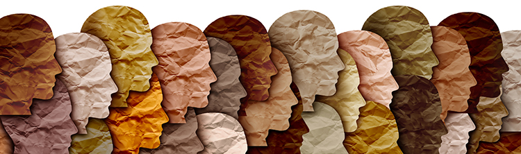 Decorative image of differently colored pieces of paper shaped like the profile of human faces overlapping one another, illustrating diversity.