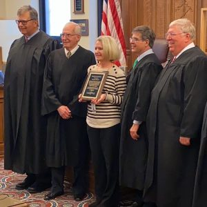 Stacey Beam stands alongside four Noble County judges.